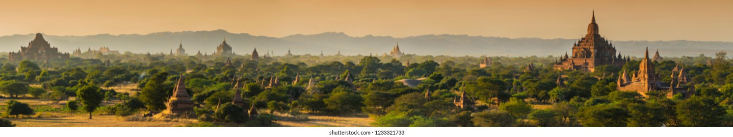 Late afternoon sun shines on Dhammayangyi Pahto Temple, Sulamani Temple and many other pagodas in the ancient city of Bagan, Myanmar. Panorama