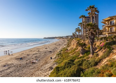 Late afternoon sun warms the bluffs in North Pacific Beach, California