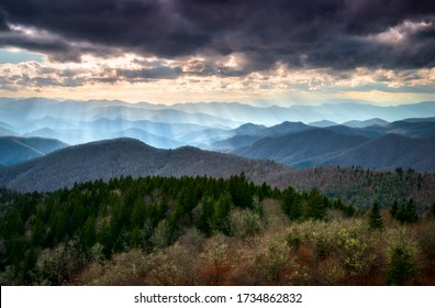 Late afternoon sunbeams shine down on the mountain peaks and ridges from a scenic overlook along the Blue Ridge Parkway in western North Carolina south of Asheville during autumn on a cold winter day. - Shutterstock ID 1734862832