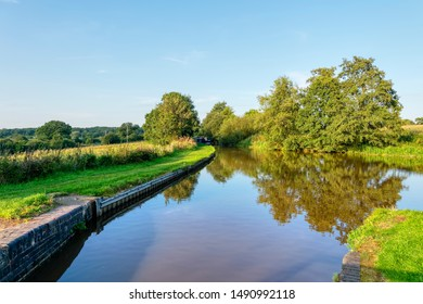Late afternoon sunlight lights up the peaceful Shropshire Union Canal near Whitchurch
