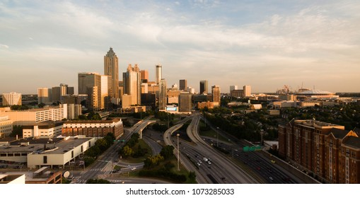 Late afternoon sunny summer day in downtown Atlanta looking from a birdseye aerial view over the highway
