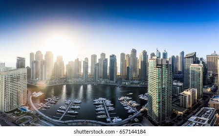 Late afternoon view of Dubai Marina taken from where yacht club which is demolished now used to be with amazing light rays through buildings.