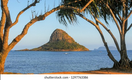 a late afternoon view of the rock formation known as Chinaman's hat in kaneohe bay, hawaii