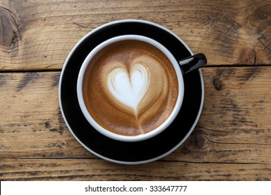 Late art coffee on wood table background