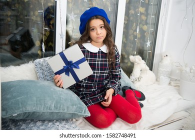 Is it too late to be good. Unhappy child on st. nicholas day. Little girl hold present box with unhappy face. Being unhappy with xmas gift. Boxing day. Santa naughty list. Unhappy and disappointed.