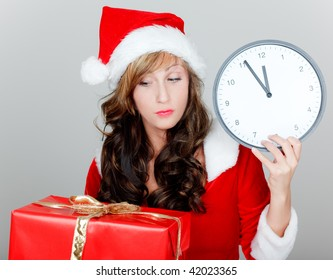 Late christmas shopping girl with santa clause hat