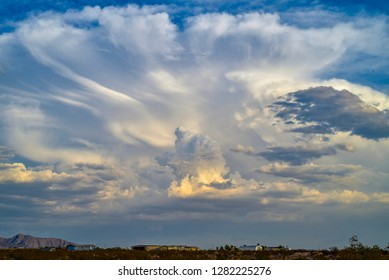 late day dusk cloud formations over buildings in desert town of Pahrump, Nevada, USA