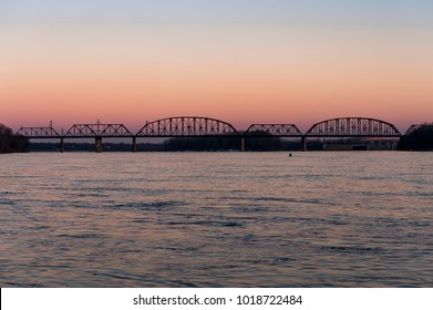 A late evening / blue hour view of the historic Kentucky and Indiana Terminal Railroad through truss bridge over the Ohio River between Louisville, Kentucky and New Albany, Indiana.