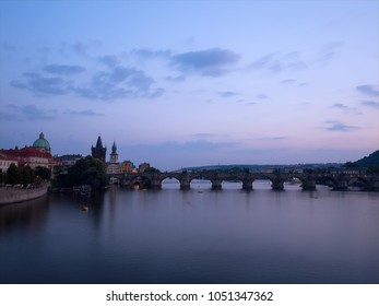 Late evening panorama of the famous medieval pedestrian only Charles bridge (Karluv Most) in the center of Prague, Czech Republic