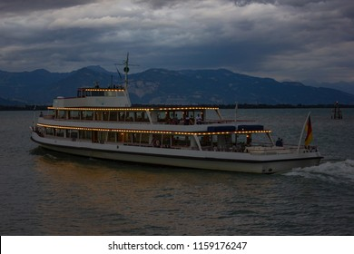 late evening passenger boat leaving harbour of city lindau at lake constance bodensee south germany