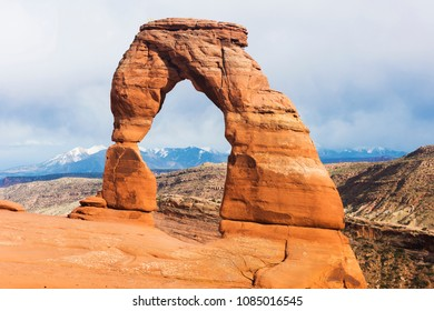 Late evening photo of a Delicate Arch with a dramatic stormy sky in the back. Arches National Park, Utah - USA
