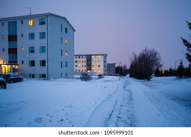 Late evening shot of modern housing covered in snow in Reykjavik, Iceland. Winter scandinavian cityscape with empty streets.