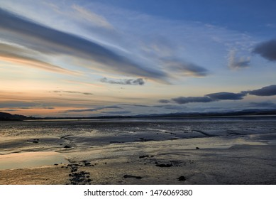 The late evening sky across the Montrose basin with the tide out and the mudflats visible, on a cold Winters evening. Angus, Scotland.