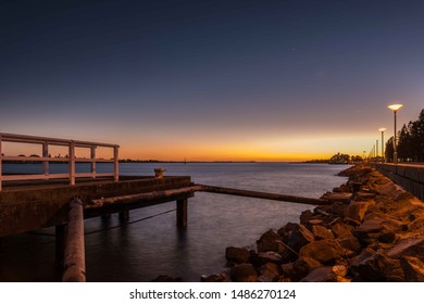 Late evening sunset over the Newcastle Harbour water at Queens Wharf Walk, Newcastle, New South Wales, Australia