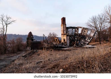 A late evening / sunset view of a collapsing house in McKeesport, Pennsylvania.