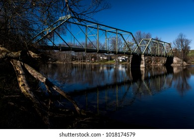 A late evening view of the historic Oneil Road through truss bridge in Cayuga County, New York.