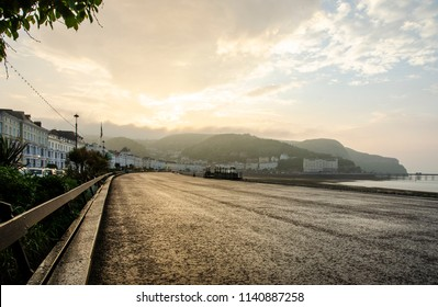 Late evening view of the promenade and beach front of Llandudno in Llandudno, Wales in June 2018