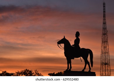 Late king statue on horse in the evening