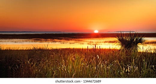 A late October sunrise over Port Royal Sound at high tide, in Beaufort County, SC, just north and a bit west of Hilton Head Island.