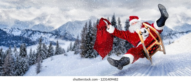late Santa claus in a hurry on sleigh sled with traditional red white costume and big gift bag in front of white snow winter landscape panorama