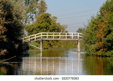 Late summer landscape view of white wooden bridges along the Gein rivier, A small river between Driemond and Abcoude, A town and former municipality in the Netherlands, in the province of Utrecht.