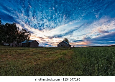 The late summer sun sets beautifully behind the old barn houses in the Northern Finland. The nights are still light, but the sunsets are something to see.