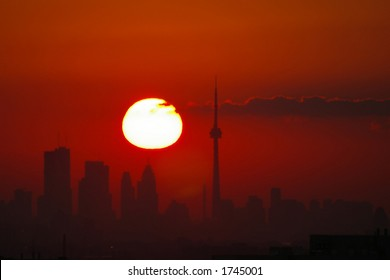 Late summer sunrise over the Toronto skyline with a few clouds