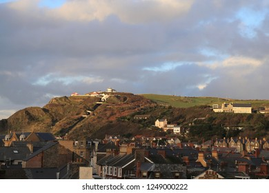 A late, sunny afternoon view across the rooftops of Aberystwyth towards the Cliff Railway and Constitution Hill.