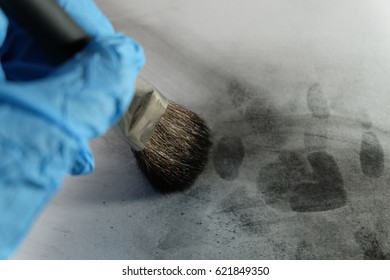 latent fingerprint searching by forensic hand in crime scene investigation