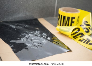 latent footprint evidence with crime scene tape in crime scene investigation