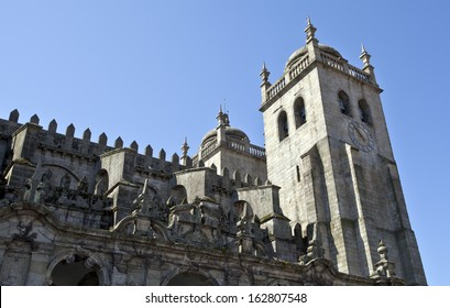 Lateral view of the bell towers of the Porto Cathedral. Originally built as a Romanesque Church, the cathedral was rebuilt and redesigned some 600 years later in Gothic style.