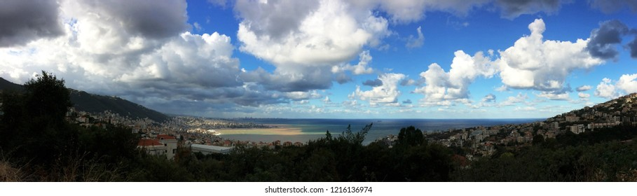 Lateral view of Jounieh, Kaslik and Beirut in background on the lebanese coast with dramatic colorful mediterranean sea and enlightment just after storm