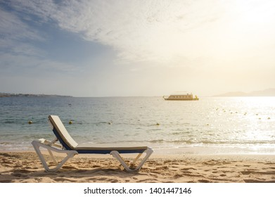 lateral view of a lounger on the beach of Red Sea coast
