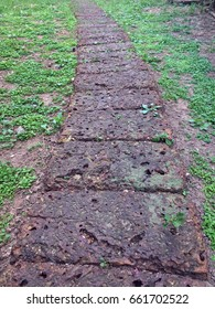 Laterite stone walkway in the park. Laterite is a soil and rock type rich in iron and aluminium, and is commonly considered to have formed in hot and wet tropical areas.