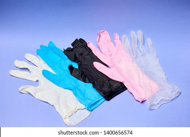 Latex gloves on a dark background. Nitrile medical gloves in different colors.