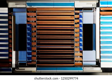 Lath structures. Double exposure photo of louvers / jalousie / blinds fragments in several different colors. Abstract image on the subject of modern architecture, interior or technology.