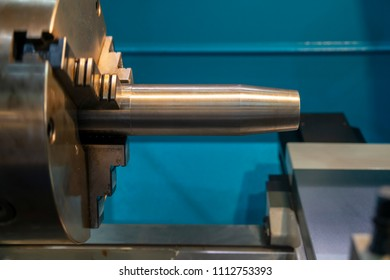 The  lathe machine cutting the steel rod.The high technology manufacturing process.
