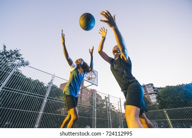 Latin and African women play basketball