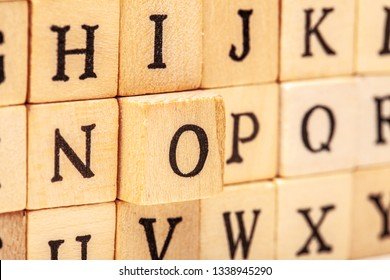 latin alphabet letters on wooden cubes