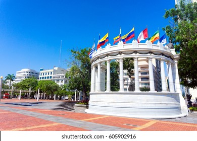 Latin American flags waving in a plaza in Guayaquil, Ecuador