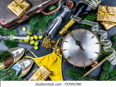 LATIN AMERICAN AND SPANISH NEW YEAR TRADITIONS. empty suitcase, lentil spoon, yellow interior clothes, gold ring in champagne, 12 grapes, money in shoe - CHILEAN MONEY. Christmas background.