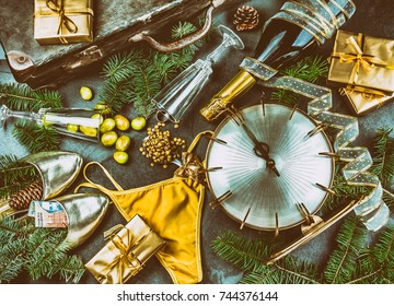 LATIN AMERICAN AND SPANISH NEW YEAR TRADITIONS. empty suitcase, lentil spoon, yellow interior clothes, gold ring in champagne, 12 grapes, money in shoe - ARGENTINE MONEY. Christmas background.