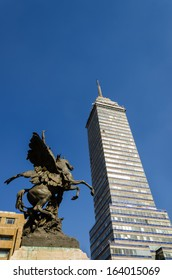 Latin American Tower, first skyscraper in Mexico City and statue
