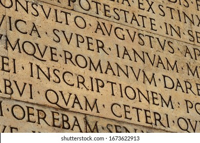 Latin ancient language and classical education. Inscription from Emperor Augustus famous Res Gestae (1st century AD), with the word Romanum in the center