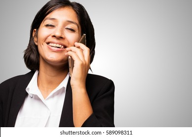 latin business woman talking on mobile telephone