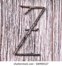 Latin capital alphabet letter Z made from  sticks on vintage surface