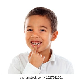 Latin child showing his new teeth isolated on a white background