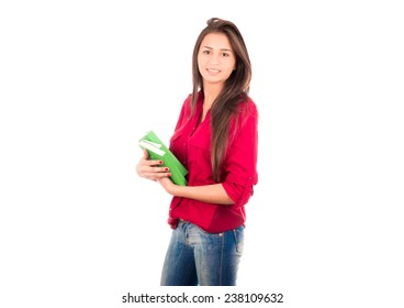 Latin college Girl Holding three big green books smiling at the camera