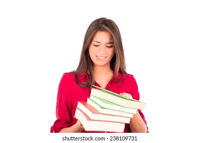 Latin college student. Holding a stack of big books. Worried look on her face.