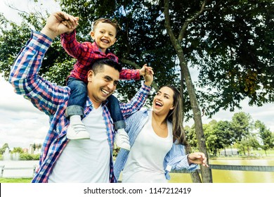 Latin family having fun at the park in the morning
